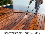 thai man do a pressure washing... | Shutterstock . vector #204861349