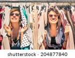 Stock photo young beautiful women at weekly cloth market best friends sharing free time having fun and 204877840
