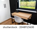 A Wooden Table With Chair Under ...