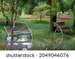 Two Wet Empty Benches In A...
