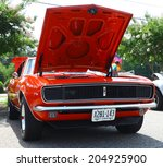 Small photo of GLOUCESTER, VIRGINIA - JULY 12, 2014: A Red 1967 Chevrolet Camaro RS in the Blast from the PAST CAR SHOW,The Blast From the Past car show is held once each year in July in Gloucester Virginia.