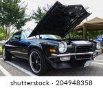 Small photo of GLOUCESTER, VIRGINIA - JULY 12, 2014:A black 1973 Z/28 Chevy Camaro in the Blast from the PAST CAR SHOW,The Blast From the Past car show is held once each year in July in Gloucester Virginia.