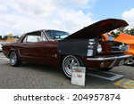 Small photo of GLOUCESTER, VIRGINIA - JULY 12, 2014:A Burgundy 1965 Ford Mustang in the Blast from the PAST CAR SHOW,The Blast From the Past car show is held once each year in July in Gloucester Virginia.