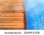Wet Wooden Flooring Beside The...
