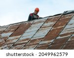 Repair Of An Old Roof On The...