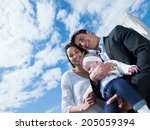 happy young family couple with... | Shutterstock . vector #205059394