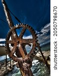 Small photo of HDR of rusty winch for pulling boats aground, Croatia.