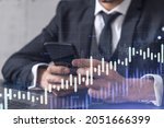 trader holding in the hands a...
