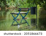 Flooded Park Bench And Trashcan ...