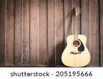 wood guitar against wall  | Shutterstock . vector #205195666