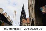 Small photo of St Lambert's Church through small human eyes : Muenster, Germany