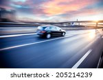 car driving on freeway at... | Shutterstock . vector #205214239