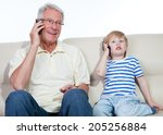 grandfather with child   Shutterstock . vector #205256884
