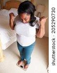 happy overweight woman standing ... | Shutterstock . vector #205290730