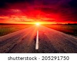 empty asphalt road to sunset  | Shutterstock . vector #205291750