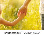 hand of parent and child | Shutterstock . vector #205347610