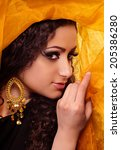 Small photo of Beautiful arabian woman in color yashmak