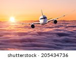 airplane at sunset | Shutterstock . vector #205434736