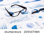 glasses and pen on blue charts  ... | Shutterstock . vector #205437484