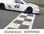 Race Car Crossing The Finish...