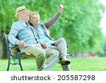 Elderly Couple Taking A Selfie...