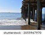 Waves Crashing Under The Dock