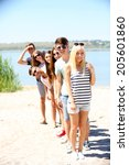 beautiful young people on beach | Shutterstock . vector #205601860