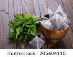 tea bags  on wooden background. ... | Shutterstock . vector #205604110