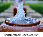 Close Up Jar Fountain In The...
