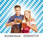 happy couple smiling with beer... | Shutterstock . vector #205643719