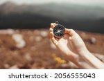 traveler hand holds a compass... | Shutterstock . vector #2056555043