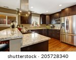 Stock photo dark brown kitchen room with steel appliances and hardwood floor 205728340