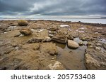 Rocky Beach At Low Tide At...