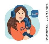 a girl in headphones talks into ... | Shutterstock .eps vector #2057567096