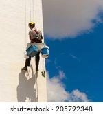a worker climbing on a wall | Shutterstock . vector #205792348