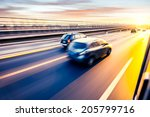 car driving on freeway at... | Shutterstock . vector #205799716