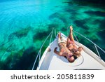 happy couple lying on a boat at ... | Shutterstock . vector #205811839