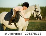 girl riding a horse on nature | Shutterstock . vector #205878118
