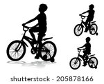 a boy rides a bike ride on the... | Shutterstock . vector #205878166