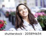 portrait of a young woman on... | Shutterstock . vector #205894654