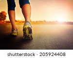 an athletic pair of legs on... | Shutterstock . vector #205924408