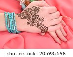 hands painted with henna on... | Shutterstock . vector #205935598