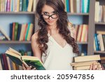 student in library | Shutterstock . vector #205947856