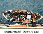 Small photo of CHILUMBA, MALAWI - AUG 17, 2009 - Passengers prepare to embark the ferry MV Ilala on August 17, 2009 in Chilumba, Malawi. MV Ilala is a motor ship that has plied lake Malawi since 1951.