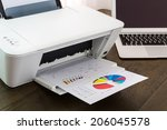 printer and laptop on wood table | Shutterstock . vector #206045578
