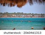 Yellow Buoys Floating On Sea...
