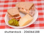 Small photo of Ham and Cheese sandwich on multi grain bread with generous mixture of seeds and grains. Add sliced tomato and slather with mayonnaise and Dijon Mustard to accentuate taste with the crunchy texture.