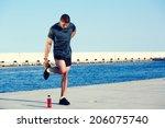 muscular male athlete doing... | Shutterstock . vector #206075740