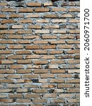 A Wall Made Of Bricks And...