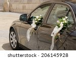 A Black Wedding Car Decorated...
